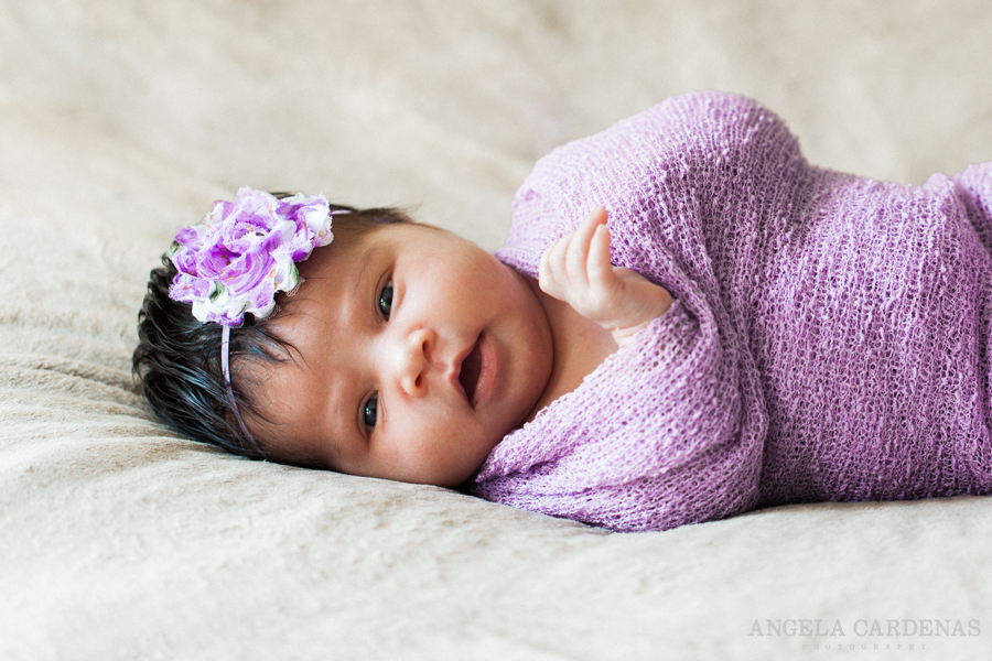 newborn baby girl with purple colors