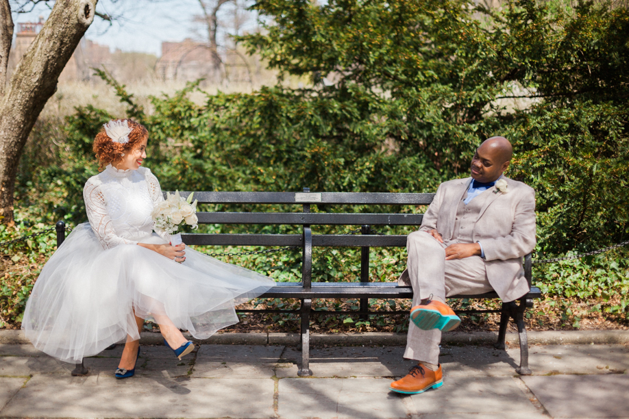 bride and groom sitting on a bench photo idea